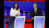 Democratic presidential candidate Rep. Tulsi Gabbard, D-Hawaii, left, and businessman Tom Steyer participate in a Democratic presidential primary debate hosted by CNN and The New York Times at Otterbein University, Tuesday, Oct. 15, 2019, in Westerville, Ohio. (AP Photo/John Minchillo)