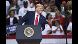 In this Oct. 17, 2019, photo, President Donald Trump speaks during a campaign rally at the American Airlines Center in Dallas. (AP Photo/Jeffrey McWhorter)