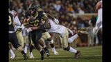 Wake Forest running back Christian Beal-Smith carries the football against Florida State in the first half of an NCAA college football game in Winston-Salem, N.C., Saturday, Oct. 19, 2019. (AP Photo/Nell Redmond)