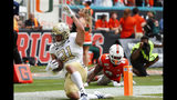 Georgia Tech running back Nathan Cottrell (31) scores against Miami defensive lineman Josh Neely (84) during the first half of an NCAA college football game, Saturday, Oct. 19, 2019, in Miami Gardens, Fla. (AP Photo/Wilfredo Lee)