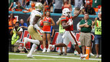Miami running back Cam'Ron Harris, right, celebrates as he scores against Georgia Tech defensive back Juanyeh Thomas (1) during the first half of an NCAA college football game, Saturday, Oct. 19, 2019, in Miami Gardens, Fla. (AP Photo/Wilfredo Lee)