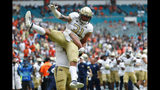 Georgia Tech running back Nathan Cottrell (31) is lifted up by tight end Tyler Cooksey during the first half of an NCAA college football game against Miami, Saturday, Oct. 19, 2019, in Miami Gardens, Fla. (AP Photo/Wilfredo Lee)