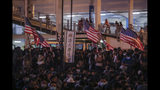 Protesters hold American flags attend a prayer rally at Edinburgh Place in Hong Kong, Saturday, Oct. 19, 2019. Hong Kong pro-democracy protesters are set for another weekend of civil disobedience as they prepare to hold an unauthorized protest march to press their demands. (AP Photo/Mark Schiefelbein)