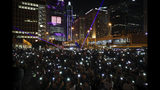 Protesters fresh their smartphone's lights to support the prayer rally at Edinburgh Place in Hong Kong, Saturday, Oct. 19, 2019. Hong Kong pro-democracy protesters are set for another weekend of civil disobedience as they prepare to hold an unauthorized protest march to press their demands. (AP Photo/Mark Schiefelbein)