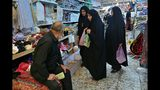 Iranian Shiite pilgrims shop outside the holy shrine of Imam Hussein ahead of the Arbaeen festival in Karbala, Iraq, Friday, Oct. 18, 2019. The holiday marks the end of the forty day mourning period after the anniversary of the martyrdom of Imam Hussein, the Prophet Muhammad's grandson in the 7th century. (AP Photo/Hadi Mizban)