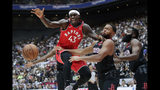Toronto Raptors' Pascal Siakam, left, fights for a loose ball with Houston Rockets' Eric Gordon during the first half of an NBA preseason basketball game Thursday, Oct. 10, 2019, in Saitama, near Tokyo. (AP Photo/Jae C. Hong)