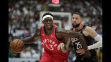 Toronto Raptors' Pascal Siakam, left, is pressured by Houston Rockets' Austin Rivers during the first half of an NBA preseason basketball game Thursday, Oct. 10, 2019, in Saitama, near Tokyo. (AP Photo/Jae C. Hong)