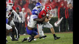 Georgia quarterback Jake Fromm (11) is brought down by Kentucky linebacker Jamar Watson (31) after a short run during the first half of an NCAA college football game Saturday, Oct. 19, 2019, in Athens, Ga. (AP Photo/John Bazemore)