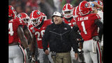 Georgia coach Kirby Smart talks to his players during a timeout in the first half of the team's NCAA college football game against Kentucky on Saturday, Oct. 19, 2019, in Athens, Ga. (AP Photo/John Bazemore)