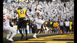 Louisiana Monroe running back Kayin White (25) runs in for a 1-yard touchdown in front of Appalachian State defensive back Ryan Huff (21) during the first half of an NCAA college football game Saturday, Oct. 19, 2019, in Boone, NC. (AP Photo/Brian Blanco)