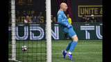 Atlanta United goalkeeper Brad Guzan reacts after blocking a shot during the first half of of an MLS Cup playoff soccer game against the New England Revolution, Saturday, Oct. 19, 2019, in Atlanta. (AP Photo/John Amis)