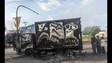 "A burnt out truck used by gunmen smolders on an intersection, a day after street battles between gunmen and security forces in Culiacan, Mexico, Friday Oct. 18, 2019. Mexican security forces backed off an attempt to capture a son of imprisoned drug lord Joaquin ""El Chapo"" Guzman after finding themselves outgunned in a ferocious shootout with cartel enforcers that left at least eight people dead and more than 20 wounded, authorities said. (AP Photo/Augusto Zurita)"