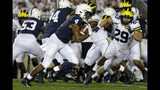 Penn State running back Journey Brown (4) runs for a first down during the first half of the team's NCAA college football game against Michigan in State College, Pa., Saturday, Oct. 19, 2019. (AP Photo/Gene J. Puskar)