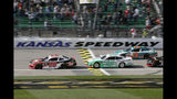 Christopher Bell (20) leads Austin Cindric (22) and Brandon Jones (19) during the first lap of an NASCAR Xfinity Series auto race at Kansas Speedway in Kansas City, Kan., Saturday, Oct. 19, 2019. (AP Photo/Orlin Wagner)