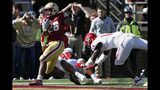 Boston College running back David Bailey (26) scores a touchdown against North Carolina State defensive end Savion Jackson (90) and safety De'Von Graves (14) during the first half of an NCAA college football game in Boston, Saturday, Oct. 19, 2019. (AP Photo/Michael Dwyer)