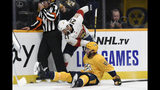 Florida Panthers center Vincent Trocheck (21) and Nashville Predators center Calle Jarnkrok (19), of Sweden, battle for the puck as referee Chris Rooney (5) tries to get out of the way during the first period of an NHL hockey game, Saturday, Oct. 19, 2019, in Nashville, Tenn. (AP Photo/Mark Zaleski)