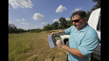 Heath Frantzen uses a map to point out the site of a proposed new natural gas pipeline that would run through his property in the Texas Hill Country, where more than 600 white-tailed and trophy axis deer graze on a 260-acre ranch his family has owned for three generations, near Fredericksburg, Texas Friday, Aug. 2, 2019. (AP Photo/Eric Gay)