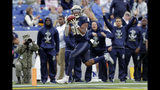 Navy wide receiver OJ Davis makes a touchdown catch on a trick-play pass from wide receiver CJ Williams during the first half of an NCAA college football game against South Florida, Saturday, Oct. 19, 2019, in Annapolis. (AP Photo/Julio Cortez)