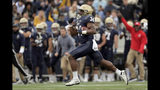 Navy fullback Jamale Carothers takes off on a scoring run against South Florida during the first half of an NCAA college football game, Saturday, Oct. 19, 2019, in Annapolis. (AP Photo/Julio Cortez)