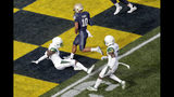 Navy quarterback Malcolm Perry (10) scores on a touchdown run as South Florida defensive back KJ Sails, left, and defensive back Mike Hampton are unable to stop him during the first half of an NCAA college football game, Saturday, Oct. 19, 2019, in Annapolis. (AP Photo/Julio Cortez)