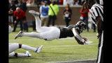 Cincinnati running back Gerrid Doaks (23) dives for a touchdown during the first half of an NCAA college football game against Tulsa, Saturday, Oct. 19, 2019, in Cincinnati. (AP Photo/John Minchillo)