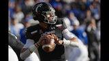 Cincinnati quarterback Desmond Ridder (9) passes during the first half of an NCAA college football game against Tulsa, Saturday, Oct. 19, 2019, in Cincinnati. (AP Photo/John Minchillo)
