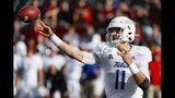 Tulsa quarterback Zach Smith (11) passes during the first half of an NCAA college football game against Cincinnati, Saturday, Oct. 19, 2019, in Cincinnati. (AP Photo/John Minchillo)