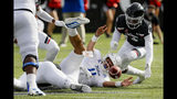 Tulsa quarterback Zach Smith (11) fumbles the ball on the run before it is recovered by Cincinnati safety Ja'von Hicks (3) during the first half of an NCAA college football game, Saturday, Oct. 19, 2019, in Cincinnati. (AP Photo/John Minchillo)