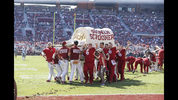 The Oklahoma Sooner Schooner is carried off the field after it tipped over during a celebratory run following a Sooner touchdown during the first half of an NCAA college football game against West Virginia in Norman, Okla., Saturday, Oct. 19, 2019. (AP Photo/Alonzo Adams)