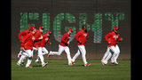 Members of the Washington Nationals participate in a baseball workout, Friday, Oct. 18, 2019, in Washington, in advance of the team's appearance in the World Series. (AP Photo/Patrick Semansky)