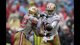 San Francisco 49ers quarterback Jimmy Garoppolo, right, hands off the ball to running back Matt Breida in the second half of an NFL football game against the Washington Redskins, Sunday, Oct. 20, 2019, in Landover, Md. (AP Photo/Julio Cortez)