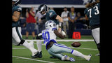 Dallas Cowboys defensive end Demarcus Lawrence (90) strips the ball away from Philadelphia Eagles quarterback Carson Wentz (11) in the first half of an NFL football game in Arlington, Texas, Sunday, Oct. 20, 2019. The Cowboys recovered the fumble. (AP Photo/Michael Ainsworth)