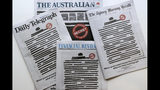 Newspapers display redacted copy on their front pages in Sydney, Monday, Oct. 21, 2019. Australia's major newspapers have published redacted front pages in a coordinated campaign to highlight government secrecy that is often justified on national security grounds. (AP Photo/Rick Rycroft)