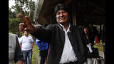 Bolivia's President Evo Morales waves to members of the press as he visits a trout farm where he stopped to eat in Incachaca, Bolivia, Saturday, Oct. 19, 2019. Morales is seeking a fourth term in Sunday's general elections. (AP Photo/Juan Karita)