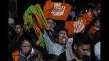 Supporters of opposition candidate Carlos Mesa celebrate after the first round presidential election in La Paz, Bolivia, Sunday, Oct. 20, 2019. Mesa will face President Evo Morales in a December election runoff. (AP Photo/Juan Karita)