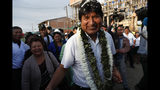 Bolivia's President Evo Morales greets followers before casting his vote in Villa 14 de Septiembre, in the Chapare region, Bolivia, Sunday, Oct. 20, 2019. Bolivians are voting in general elections Sunday where Morales is Presidential candidate for a fourth term.(AP Photo/Juan Karita)