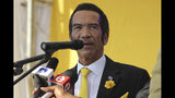 FILE - In this Aug. 3, 2019, file photo, former Botswana President Ian Khama attends an election rally in Gaborone, Botswana. Botswana's ruling party, the BDF (Botswana Democratic Party), faces the tightest election of its history on Wednesday, Oct. 23, 2019 after Khama, annoyed with his hand-picked successor, President Mokgweetsi Masisi, announced his support for the opposition. (AP Photo/File)