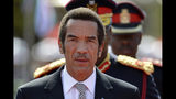FILE - In this Oct. 28 2014, file photo, Botswana President Ian Khama attends a swearing-in ceremony for a second and final term as Botswana's president at the National Assembly buildings in Gaborone. Botswana's ruling party the BDF (Botswana Democratic Party) faces the tightest election of its history on Wednesday, Oct. 23, 2019 after Khama, annoyed with his hand-picked successor, President Mokgweetsi Masisi, announced his support for the opposition. (AP Photo/File)