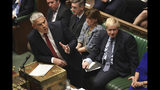 Secretary of State for Exiting the European Union lawmaker Stephen Barclay speaks during the Brexit debate, watched by Prime Minister Boris Johnson, right, inside the House of Commons in London Saturday Oct. 19, 2019. At the rare weekend sitting of Parliament, Prime Minister Boris Johnson implored legislators to ratify the Brexit deal he struck this week with the other 27 EU leaders. Lawmakers voted Saturday in favour of the 'Letwin Amendment', which seeks to avoid a no-deal Brexit on October 31. (Jessica Taylor/House of Commons via AP)
