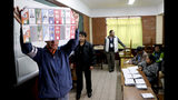 CORRECTS COUNTRY - Electoral officials count ballots after polls closed for presidential elections in La Paz, Bolivia, Sunday, Oct. 20, 2019. Polls closed after a calm election as President Evo Morales sought an unprecedented fourth term in what was regarded as the tightest race of his political career. (AP Photo/Jorge Saenz)