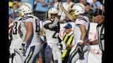 Los Angeles Chargers running back Melvin Gordon (25) is congratulated by quarterback Philip Rivers, right, after Gordon scored a touchdown against the Tennessee Titans in the first half of an NFL football game Sunday, Oct. 20, 2019, in Nashville, Tenn. (AP Photo/James Kenney)