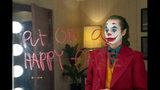 """This image released by Warner Bros. Pictures shows Joaquin Phoenix in a scene from the film, """"Joker."""" (Niko Tavernise/Warner Bros. Pictures via AP)"""
