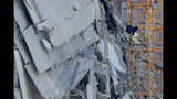 Workers prepare two unstable cranes for implosion at the collapse site of the Hard Rock Hotel, which underwent a partial, major collapse while under construction last Sat., Oct., 12, in New Orleans, Saturday, Oct. 19, 2019. (AP Photo/Gerald Herbert)