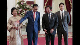 Indonesian President Joko Widodo, second left, directs Brunei's Sultan Hassanal Bolkiah, second right, as Widodo's wife Iriana, left, and Bolkiah's son Abdul Mateen look on during their meeting ahead of Widodo's inauguration, at Merdeka Palace in Jakarta, Indonesia, Sunday, Oct. 20, 2019. (AP Photo/Dita Alangkara)