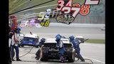 Chris Buescher (37) pits during a NASCAR Cup Series auto race at Kansas Speedway in Kansas City, Kan., Sunday, Oct. 20, 2019. (AP Photo/Colin E. Braley)