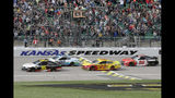 Matt DiBenedetto (95), Landon Cassill (00), Joey Logano (22) and Parker Kligerman (96) take the green flag during a NASCAR Cup Series auto race at Kansas Speedway in Kansas City, Kan., Sunday, Oct. 20, 2019. (AP Photo/Orlin Wagner)