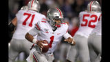 Ohio State quarterback Justin Fields (1) scrambles during the first half of an NCAA college football game against Northwestern, Friday, Oct. 18, 2019, in Evanston, Ill. (AP Photo/Charles Rex Arbogast)