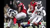 Los Angeles Rams cornerback Jalen Ramsey (20) hits Atlanta Falcons running back Devonta Freeman (24) causing a fumble during the first half of an NFL football game, Sunday, Oct. 20, 2019, in Atlanta. (AP Photo/John Bazemore)