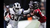 Los Angeles Rams defensive back Nick Scott (33) hits Atlanta Falcons defensive back Jordan Miller (28) during the first half of an NFL football game, Sunday, Oct. 20, 2019, in Atlanta. (AP Photo/John Bazemore)