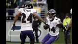 Baltimore Ravens cornerback Marlon Humphrey (44) celebrates with cornerback Marcus Peters (24) after recovering a Seattle Seahawks fumble and running for a touchdown during the second half of an NFL football game, Sunday, Oct. 20, 2019, in Seattle. (AP Photo/Elaine Thompson)